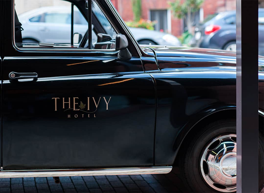 Logo on the door of The Ivy Baltimore's London Cab.