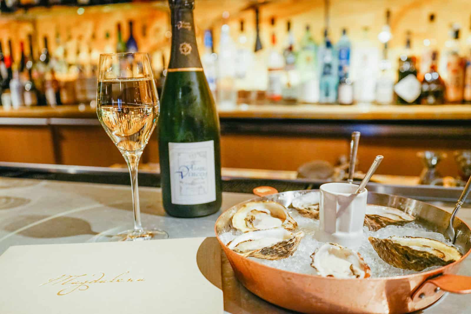 Fine wine and raw oysters while seated at the bar inside Magdalena. With a variety of seating areas, this restaurant is located within the Ivy Hotel