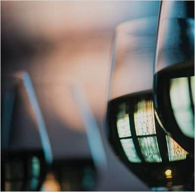 Close-up photography of wine glasses filled with red wine at The Ivy Baltimore