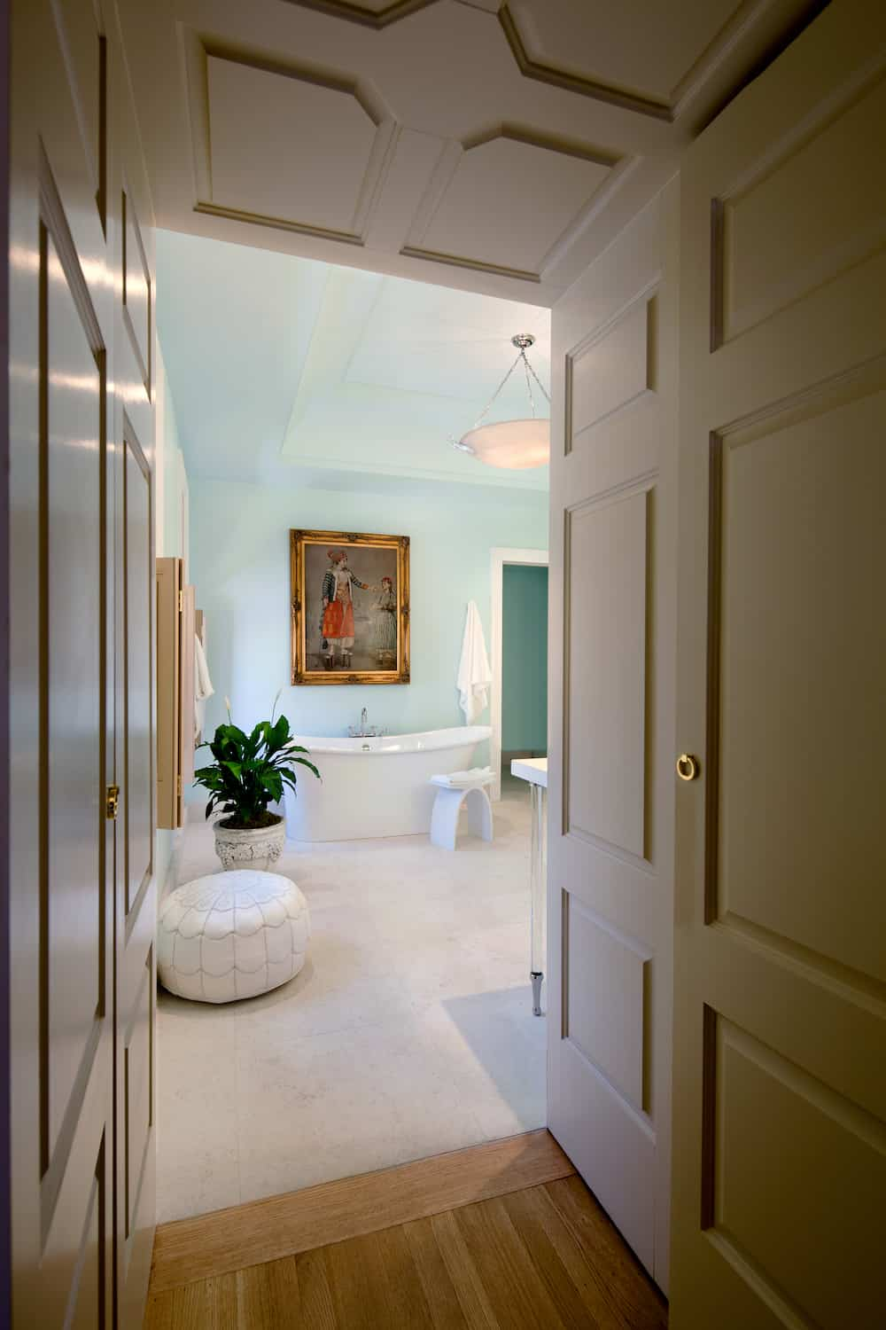 In the hallway leading to Suite Seven's Bathroom. The large tub is just below an oil painting.