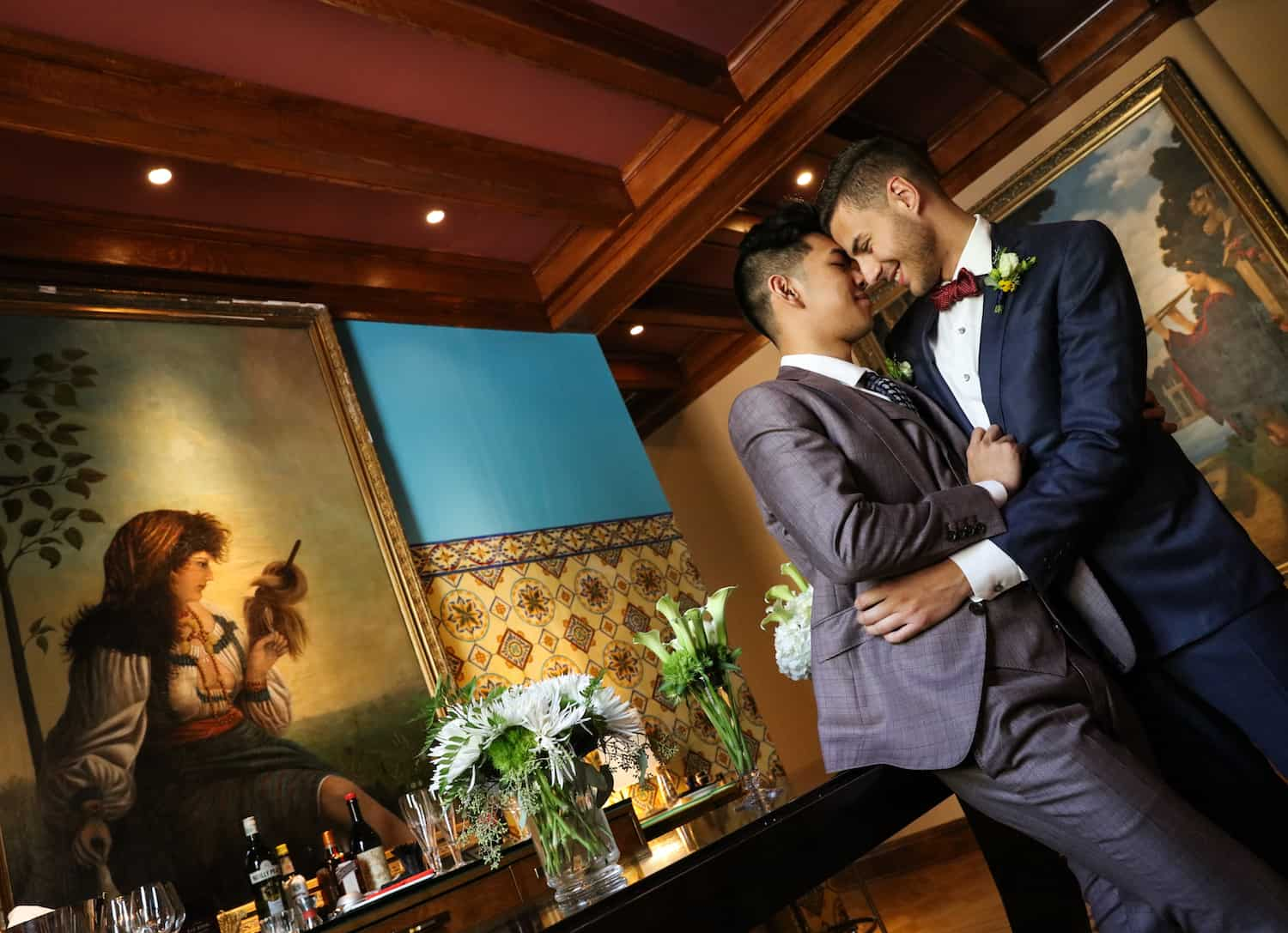 Couple sharing a tender moment in the Mansion Bar.
